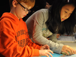 Boy and girl doing craft for their animation project during Animating History field trip to Richmond Museum.
