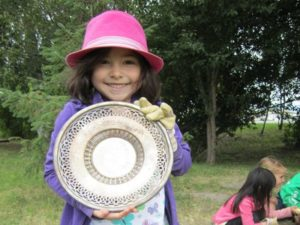 Girl holding a large plate