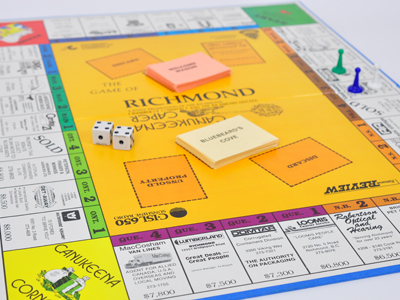 The Canukeena Caper boardgame, modelled after Monopoly, in play.
